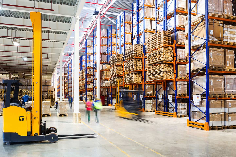 Stocking shelves in large warehouse